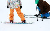 Snowboarder and skier — Stock Photo