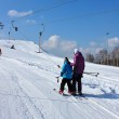 Skiers on the lift — Stock Photo
