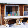 Wooden house in snow — Stock Photo #9772054