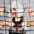 Fashion girl behind a mesh — Stock Photo #8538659