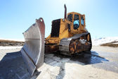 Snow-cleaning bulldozer — Stock Photo
