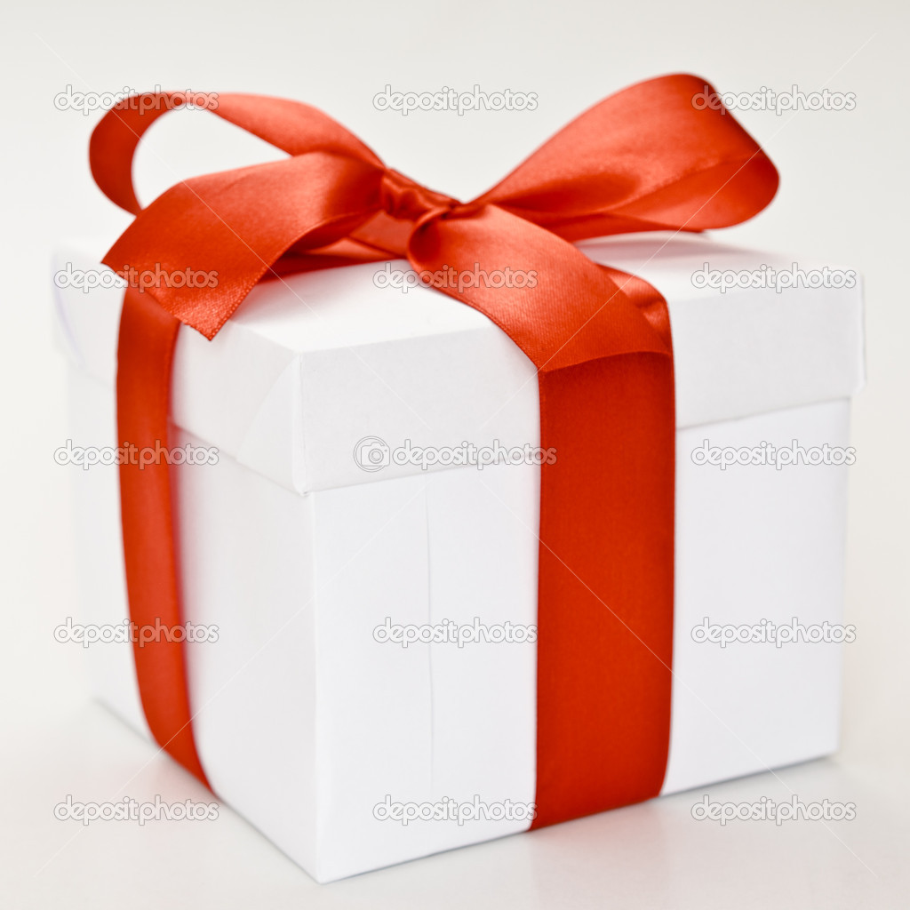 White gift box with red ribbon isolated on white — Stock Photo #8341505