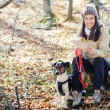 Woman hiking with dog - Foto Stock