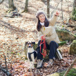 Stock Photo: Woman hiking with dog