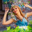 Portrait of beautiful woman in blooming tree in spring — Stock Photo #9189724