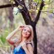 Portrait of beautiful woman in blooming tree in spring — Stock Photo #9189744