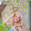 Portrait of beautiful woman in blooming tree in spring — Stock Photo #9189749