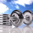 Barbells on the sky — Stock Photo