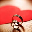 Beautiful wedding golden rings with a heart — Stock Photo