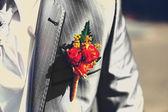 Beautiful wedding boutonniere at groom's costume — Stock Photo
