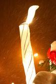 Closeup of burning candle at winter night — Stock Photo