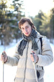 Attractive young man cross-country skiing (portrait) — Stock Photo