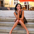 Adorable brunette with sexual legs in Old Riga — Stock Photo #8961139