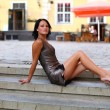 Adorable brunette with sexual legs in Old Riga — Stock Photo #8961143