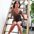 Brunette in full length with sexual legs on staircase — Stock Photo #8961146