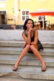 Adorable brunette with sexual legs in Old Riga — Stock Photo