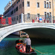 Gondola and gondolier in Venice — Stock Photo