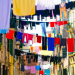 Beautiful venetian street with clothes — Stock Photo