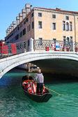 Gondola and gondolier in Venice — Stock Photo