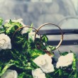 Wedding bouquet and big golden rings — Stock Photo