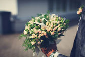 Beautiful wedding bouquet of roses — Stock Photo