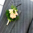 Beautiful wedding boutonniere at groom's costume — Stock Photo