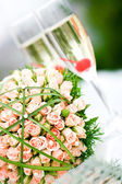 Luxury wedding bouquet of roses with champagne — Stock Photo