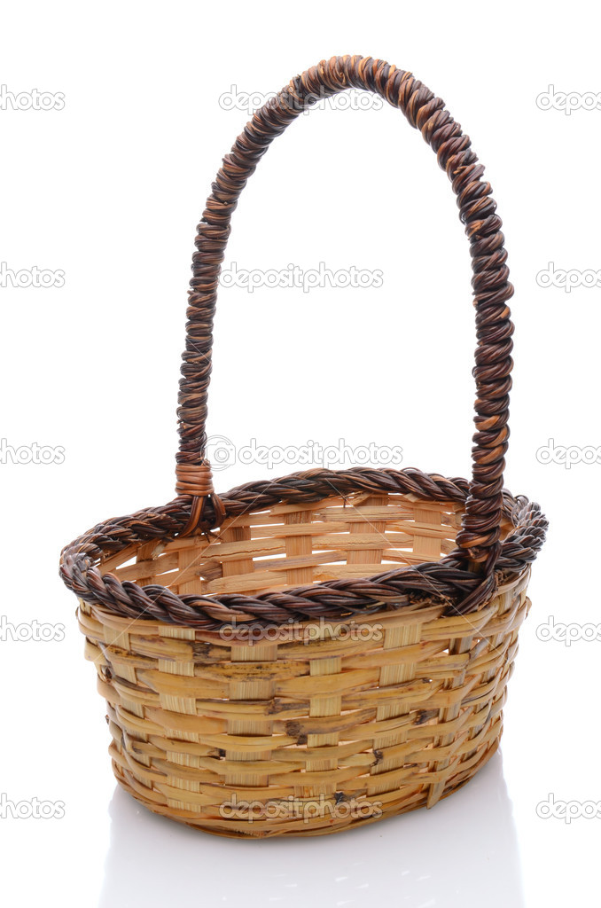 Oval wicker basket with handle isolated on a white background with slight reflection. — Stock Photo #10533883