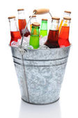 Assorted Soda Bottles in Ice Bucket — Stock Photo