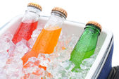 Closeup of three soda bottles in ice chest — Stock Photo