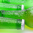 Closeup of Green Beer Bottles Laying on Their Side - Stock Photo