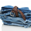 Stack of Denim Blue Jeans with Belt - Stock Photo