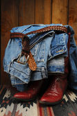 Blue Jeans draped over Cowboy Boots — Stock Photo