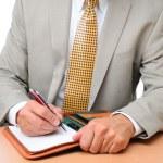 Closeup Businessman Writing in Notebook — Stock Photo