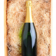 Champagne Bottle in Wood Crate — Stock Photo