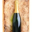 Champagne Bottle in Wood Crate - Stock Photo