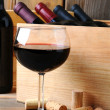 Wine Glass in Front of Wood Case — Stock Photo