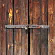 Old Wooden door locked with rusty padlock — Stock Photo