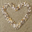 Stock Photo: Heart arranged from Seashells