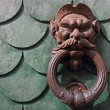 Vintage rusty door knocker in Pisa Italy — Stock Photo
