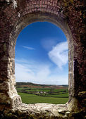 Old Arch with landscape view — Stock Photo