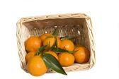 Satsumas in a wicker basket — Stock Photo