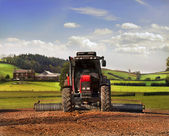 Tractor working the land — Stock Photo