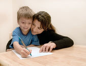 Mother and son doing homework. — Stock Photo