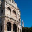 Coliseum and church tower in Pula — Stock Photo