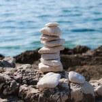 Pebble stone pyramid — Stock Photo #10455017