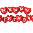 Red Happy Birthday heart shape balloons — Stock Photo