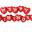 Red Happy Birthday heart shape balloons — Stock fotografie
