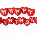Red Happy Birthday heart shape balloons — Stock Photo