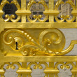 Detail of golden door of Versailles Palace. France - Stock Photo